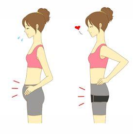 股関節ベルトで骨盤調整をする女性